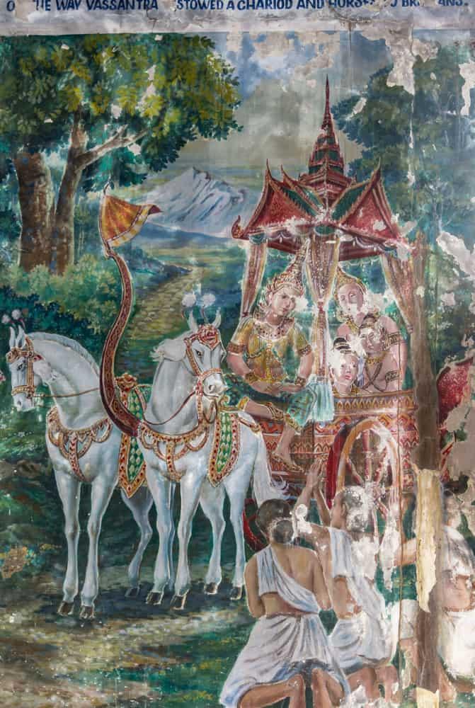 Zwei Pferde mit Kutsche und mehreren Personen stellen eine Episode aus dem Leben Buddhas dar